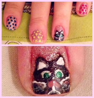 """Adorable colorful nail art with a little """"meow"""" detail <3"""