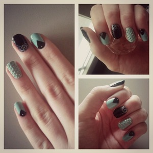 blue and black nails with glitters and studds