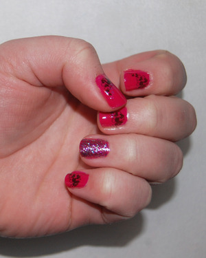 Valentine's Day Mani- China Glaze Fuchsia Fanatic, OPI Glow It And Show It, Icing Jet Black, Konad plate m59  http://jessbeez.blogspot.com/2012/02/valentines-day-214-china-glaze.html