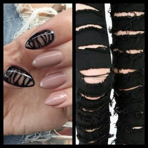 Acrylic stiletto nails. Nude color is Gelish My Nightly Craving. Design painted in Black on Black by Sinful Colors with a thin paintbrush