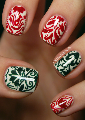 I love the symmetry of damask print so I used it as the inspiration for these hand-painted festive nails!  http://www.dressedupnails.com/2012/12/the-digit-al-dozen-does-festiveness-day_14.html
