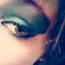 Blue eye shadow with pink eye brows