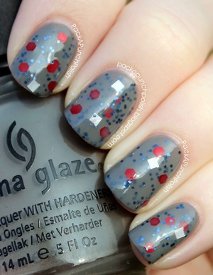 This is Santa In The Sky by Femme Fatale Lacquer. Femme Fatale Lacquer is an indie nail polish brand. This polish has a grey base with small navy blue glitters, larger red hex, and white squares. This is one coat over two coats of China Glaze Recycle with a coat of Out The Door top coat.  Her shop: http://femmefatalelacquer.bigcartel.com Her facebook: http://facebook.com/femmefatalelacquer Her instagram: @femmefatalelacquer http://instagram.com/femmefatalelacquer  Full Blog Post: http://packapunchpolish.blogspot.com/2012/12/santa-in-sky-by-femme-fatale-lacquer.html