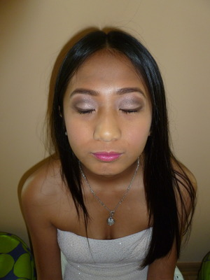a brown look with shimmer and pink undertones, with a pink lip