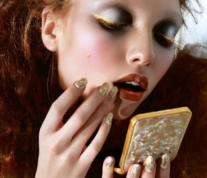 gold eyeliner, pewter eye, copper lip, gold foil nails, red hair