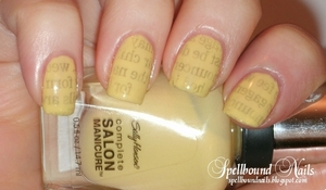 http://spellboundnails.blogspot.com/2012/03/yellow-kitty-newspaper-nails.html