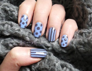 http://polishedindulgence.blogspot.com/2012/03/nail-art-wednesday-somber-dots-and.html