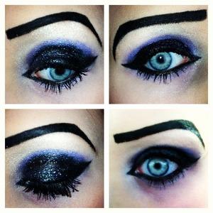 Glittery black eyeshadow with purple crease and cat eye.