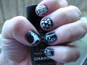 Chanel Black Satin, Konad stamping plates, and a hot topic stamping plate I bought years ago :)