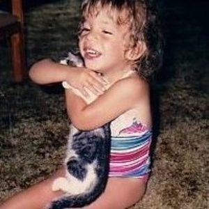 Me when I was about 4 holding my cat Bacall. We had another cat named Bogart. :)