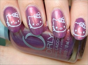 More photos here: http://www.swatchandlearn.com/nail-art-hello-kitty-nails/