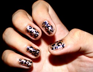 """I call it """"Feline obsession"""". You can never go wrong with animal prints : )"""