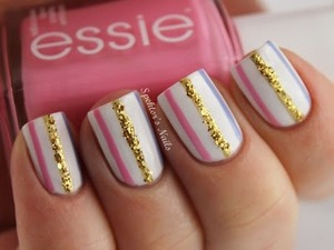 Cute nail design with stripes and a little bit of glitter.