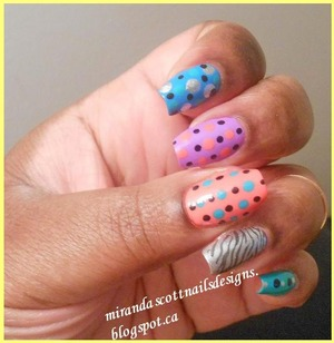For the below manicure I did a skittles manicure with colourful polka dots. I like these types of manicures especially in the summer time it's bright and fun. The polishes I used were Sally Hansen Coral Reef, Sally Hansen Blue me Away, Sally Hansen Black Out and Celb City. And also used China Glaze That's Shore Bright and China Glaze Four Leaf Clover.