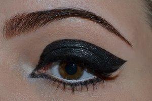 Sleek, black, glitter eyes.