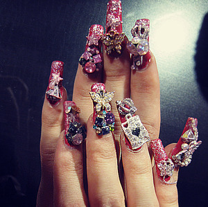 heavily decorated acrylic nails that i made for a friend