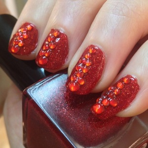 "I felt like some red finger tips and the urge to use many a rhinestone was too strong. I had an idea to create blood drops as a halloween idea and the Glitter Gal polish Type O jumped out at me. Its ""bloody"" gorgeous deep colour and amazing sparkle a plenty did not leave me wanting."