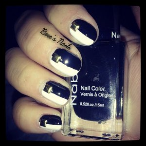 a bold monochrome striped mani with gold square studs to accent the nails.