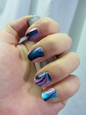 My First Water Marble Nails!  Blog post here: http://rivuletsbeauty.blogspot.com/2012/01/notd-my-first-water-marble-nails.html