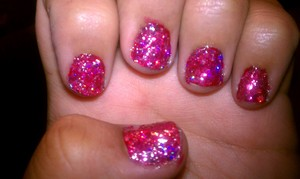 Sprakley Red nails base polish red and red sparkle sequince  with a clear top coat to seal in the sequince