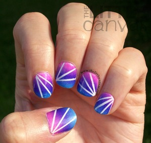 A little tape, a little gradient, and masterpiece. http://www.thelittlecanvas.com/2013/06/gradient-laser-tape-manicure.html