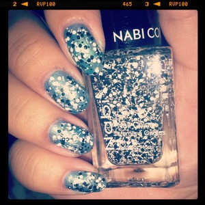 a sheer baby blue with encapsulated black and white chunky glitter :)