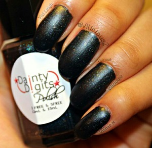 Here's a swatch of Dainty Digits Polish Suburban Blackout without top coat! It dries with a lovely matte finish.♡