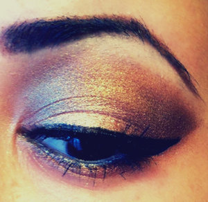 This Smokey Eye is perfect for homecoming! Gold & Plum with a hint of Pink paired up with false lashes & liquid liner