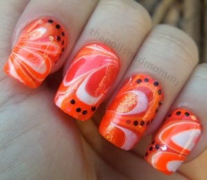 Full details here: http://www.thepolishedmommy.com/2012/10/halloween-watermarble.html