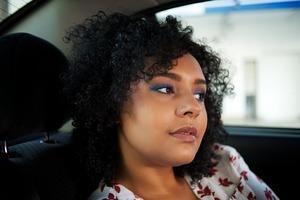 Rainbow in Rio inspired eyes: smokey purple eyeshadow and deep blue on the crease, blue metalic eyeliner, green eyeshadow on the bottom lashline, black mascara. clear lips. Highlighter + peach blush.