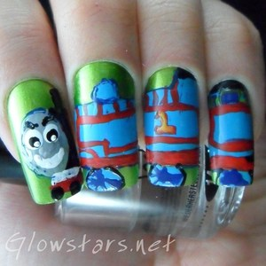To find out how to achieve this Thomas the Tank Engine mani please visit http://glowstars.net/lacquer-obsession/2012/09/30-days-of-untrieds-inspired-by-a-movie