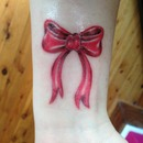 cute bow tattoo