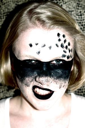 Elaborate makeup design. Avant-garde perspective of a masked ball.
