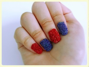This is a photo on red and blue caviar nails. I tried this for the first time and it turns out I like it (: I have a video on how I did it (: