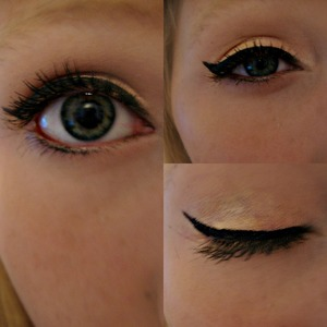 A peach color eye shadow with gold in the outer corner.