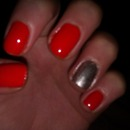 Orange nails with silver accent nail