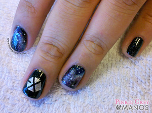 Exo fan-requested nail art. Orly Goth base with galaxy nails and Exo logo on middle finger. Read more at: http://pinkiegrey.com/post/40972657510/exoplanet-korean-pop-band-exo-performed-in-manila