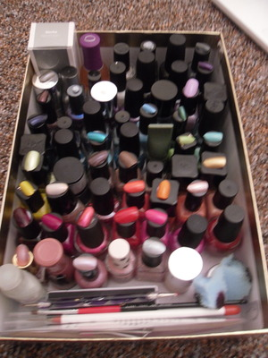 i just keep my nail polish in a shoe box, nothing special. but because of this i find it hard to find colours of nail polish. to help me i decided to use a box of fake nails that i don't use and painted them with each colour. i then used blu tac to stick the nails to the polish lids. i also put the colours in similar groups then from lightest to darkest. i did this a while ago so half of the nails have come of now but i will defiantly be redoing them. hoe this helps anyone who can't afford fancy stands like me :)