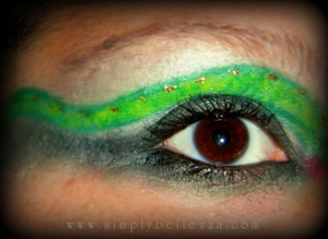 Just what the title says--a green snake inspired makeup look. I'm not sure if I like it with the long, extended crease line, but if I could redo it, I would instead take the cut crease line and create a coiled up snake on the outer corner. =)