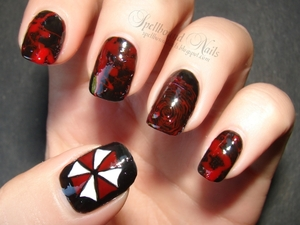 Blood splatter, blood splatter, bloody fingerprint, blood splatter, and the Umbrella Corporation symbol. http://spellboundnails.blogspot.com/2012/09/resident-evil-retribution.html