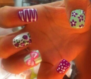 green, purple, white, design w/ cheetah print, flowers, polka, and striped w/ pink and white 3d bow