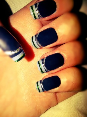 black nails with silver glitter, green glitter and grey stripes on tips