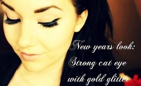 New Years Makeuplook: Bold cateye with goldglitter