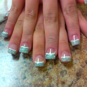 Free form acrylic nails with silver glitter tips and white line