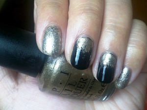 Black nails (OPI Black Onyx) with gold overlay (OPI Glitzerland) paired with glitter accent nails (OPI Crown Me Already! over OPI Glitzerland).