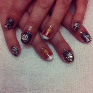 Candy corn, spider webs and 3d spiders all done using shellac.