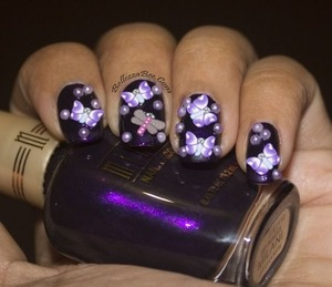 Fimo butterflies and pearls http://www.bellezzabee.com/2013/03/nail-challenge-day-5-purple-butterflies.html