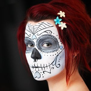 what is a good costume for this face below im being a sugar candy skull i have an obsession with them i think something like a victorian dress would