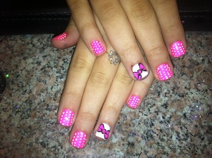 Shocking pink from china glaze  White cm polish with painted acrylic paint bow n polka dot