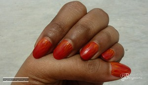 """** OPEN ME TO READ **  Hi Guys,    I call this the Fire or Wave effect, it kind of reminds me both.. Well I have to say this, its another easy nail art tutorial for you guys.. Try it out with different shades that you have, do post a picture of it in my Facebook page.. I would love to see how it came out for you :).. I hope you like this video :D..  Do share your views with me.. Thank you so much for watching my video :D.. Your support means a lot to me :)).. Please don't forget to like,share and comment..     If you want to view pictures, visit my blog: (will put up soon)     Disclaimer:  I have bought the product's mentioned in the video with my money.. Any reviews/thoughts/etc about it is my own opinion.. I am in no way affiliated with the company..     you might also like to view the: other nail art tutorial's that I have done 1. Tutorial : Nail Art : Marble Nail Art Effect Without Water     http://www.youtube.com/watch?v=M3TzhX3btmI 2. Tutorial : Nail Art : Using KONAD image plate m73     http://www.youtube.com/watch?v=7podhopcVtI 3. Tutorial : Nail Art : Effect created using plastic bag     http://www.youtube.com/watch?v=fXRogE_dw8g 4. Tutorial : Nail Art : Color Blocking effect     http://www.youtube.com/watch?v=HNDS2eROriA 5. Tutorial : Nail Art : Braided effect    http://www.youtube.com/watch?v=CQv4ckthYnU 6. Tutorial - Nail Art - Ombre / Gradient effect .. Easy Valentine's Day nail art     http://www.youtube.com/watch?v=4EjFjw-ANEE  nail polish's that I have reviewed 1. ELLE 18 Color Bomb collection nail polish number 34 review     http://www.youtube.com/watch?v=J2wmLuYKClg 2. review : Earthen Rose nail polish number 68 by COLORBAR     http://www.youtube.com/watch?v=WJVfm2icfS4     to download this song """"Sparkle"""", visit the link mentioned below http://www.vimalkrishna.com/images/music/sparkle-vimal.mp3     follow me:  Beautylish: http://www.beautylish.com/BangaloreBengaluru Blog: http://bangalorebengalurublog.blogspot.in Face Book: http://www.facebook.com/"""